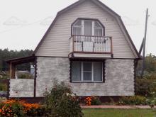 Отделка дома виниловым и цокольным сайдингом
